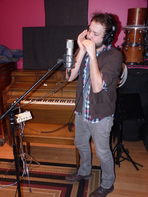 David laying down the harmonica